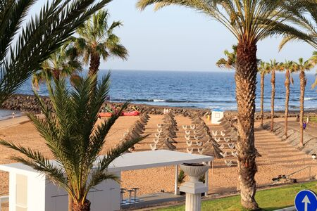 Beach and Atlantic Ocean panorama in holiday resort Playa de las Americas on Canary Island Tenerife, Spain