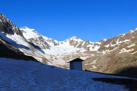 Mountain snow panorama with glacier Sexegertenferner and blue sky in Tyrol Alps, Austria Фото со стока