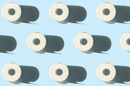 quarantine concept toilet paper rolls with shadow pattern on blue background