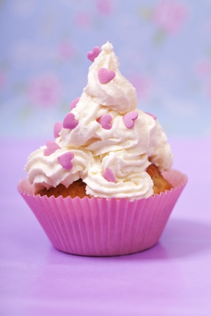 cupcake with pink hearts party closeup photo