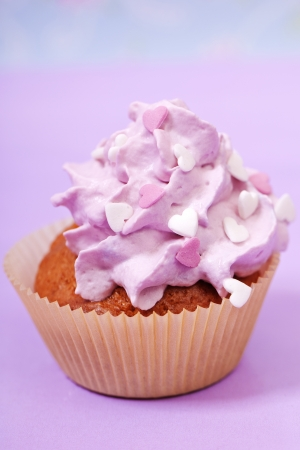 calories poor: pink cupcake with white and pink hearts Stock Photo