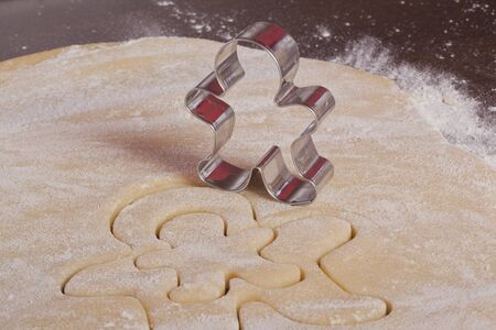 cutting cookies dough gingerbread man  shape homemade for christmas