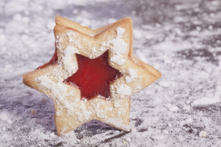 Jelly cookies star with red jam homemade  photo