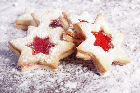 christmas atmosphere: Jelly cookies star with red jam homemade