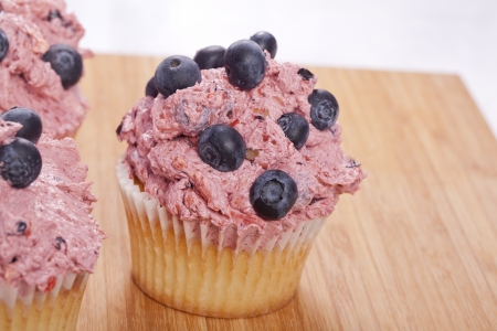 calories poor: sweet fresh homemade blueberry cupcakes summer dessert Stock Photo