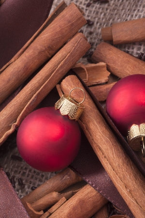 christmas scent: red Christmas tree ornaments and cinnamon sticks