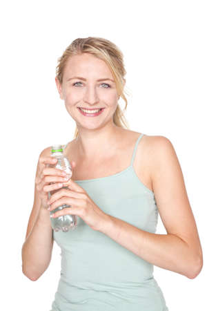 young blond woman drinking water after sport