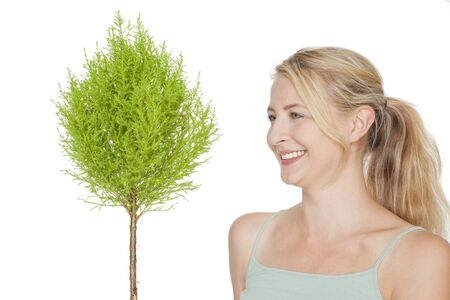 young blonde woman with green  bonsai tree