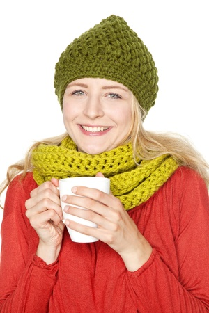 young girl in winter drinking hot grog