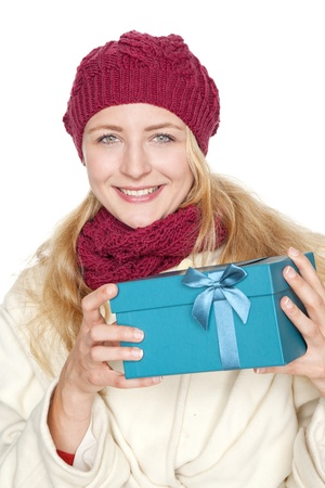 young blond woman get a gift for christmas photo