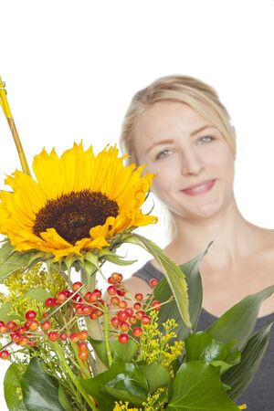 cute young blond woman with sunflower bouquet