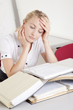 unsuccessfully: stressed and overworked  young businesswoman in the office Stock Photo
