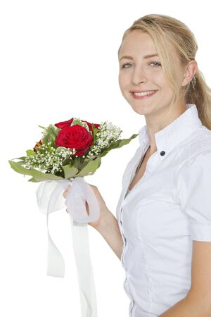 young blond woman with a bouquet of red roses photo