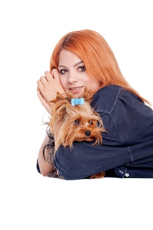 redhead young woman with cute little yorkshire terrier photo