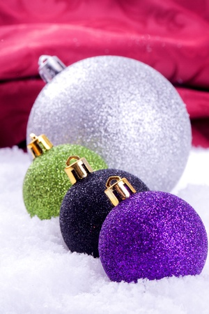 christmas ball decoration with snow and red background Stock Photo