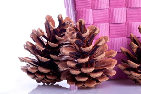decotating Pine Cones in a wooden basket  Stock Photo