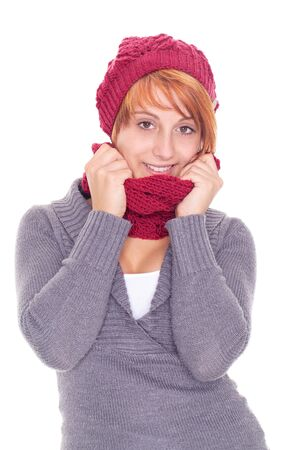 young woman with scarf and cap on a winter day photo
