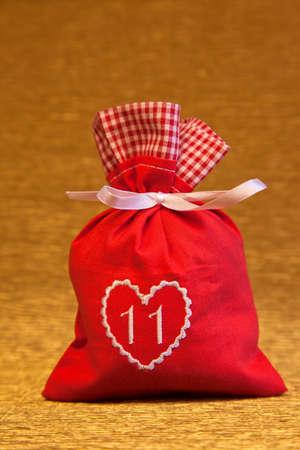 timepieces: handmade advent calendar red bag with heart symbol Stock Photo