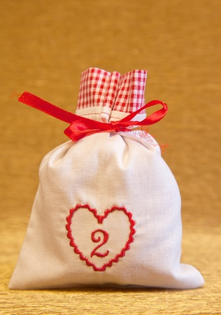 handmade advent calendar white bag with heart symbol photo