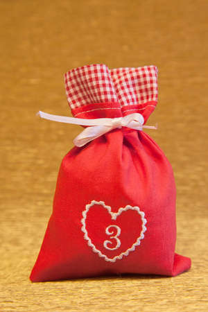 handmade advent calendar red bag with heart symbol photo