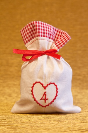 handmade advent calendar white bag with heart symbol