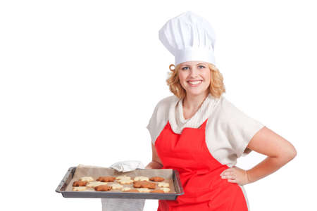 woman holding a bake sheet with christmas cookies photo