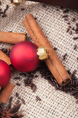 festively: red Christmas tree ornaments and cinnamon sticks