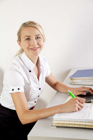 young businesswoman with file folder in the office photo