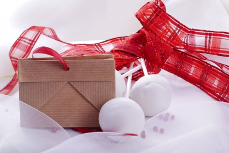 white sweet cakepop with red decoration for wedding photo