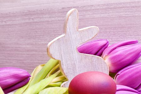 wooden easter decoration bunny with pink tulip flowers Stock Photo - 17536261