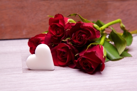red roses with heart decoration for wedding mothers day and valentines day photo