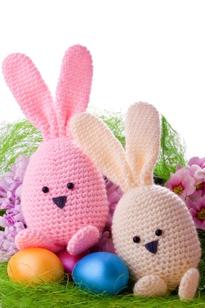 handmade easter bunny with colorful flowers and easter eggs