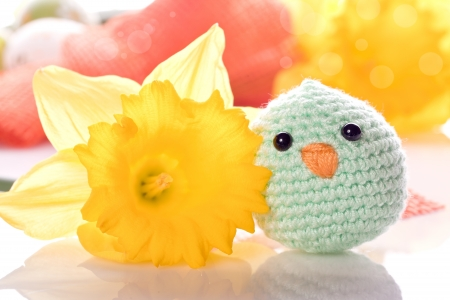spring decoration with chick ribbon and flowers
