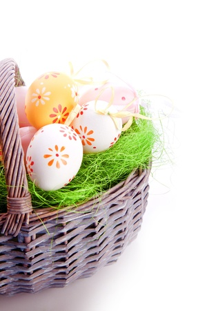 dyed: dyed easte eggs on grass in a basket  Stock Photo