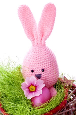 pink handmade easter bunny with easter eggs and spring flowers Stock Photo
