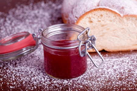 braided sweet bread with red strawberry jam photo