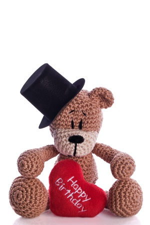 teddy bear with stovepipe and happy birthday heart pillow photo