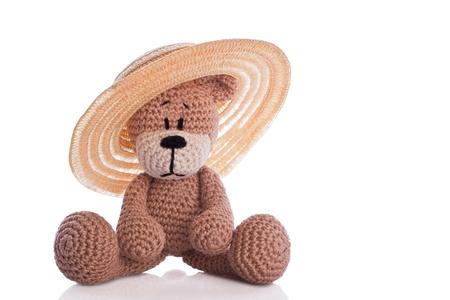 brown teddy bear with sun hat Stock Photo