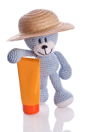sunburnt: blue teddy bear with hat and suncream lotion