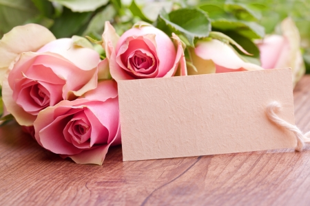 birthday flowers: pink roses with gift card Stock Photo
