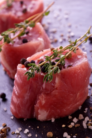 raw fresh filet with thyme salt and pepper photo