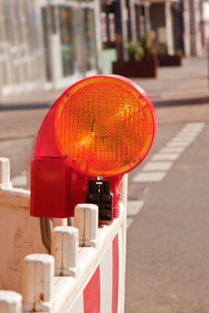 orange road construction lamp and barrier Stock Photo