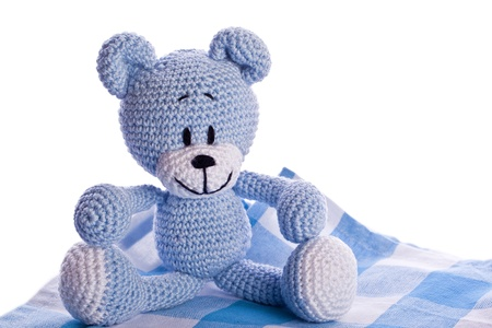 teddy bear on blue and white picnic blanket photo