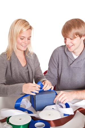 couple wrapping gifts for christmas photo
