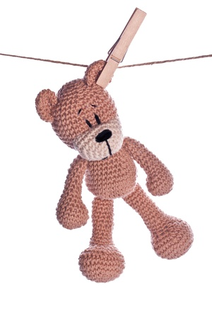 teddy bear with clothespin on a rope