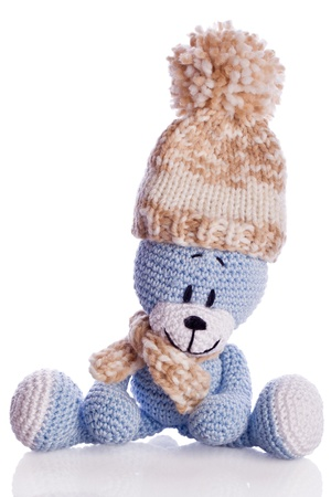 bobble: teddy bear with  scarf and bobble cap in winter Stock Photo