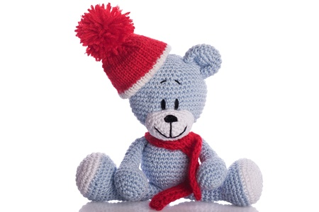 teddy bear with  scarf and bobble cap in winter Stock Photo