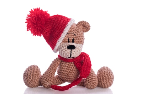 teddy bear with  scarf and bobble cap in winter photo