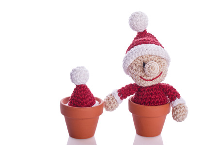 two christmas gnome in a plant pot decoration photo