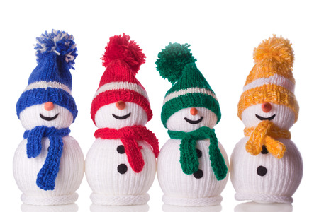 group of snowman with hat and scarf Stock Photo